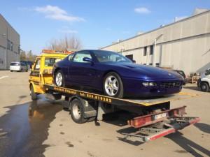 Carroattrezzi a Modena H24. Carro attrezzi Idea Auto con Ferrari blu